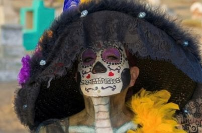 A women in traditional dress for the annual Baja Day of the Dead celebration